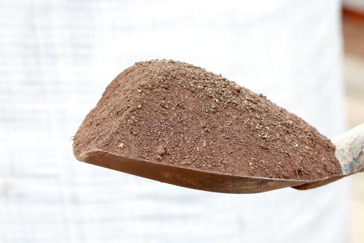Image , Compost soil, Organic plant fertilizer on a shovel for plantation
