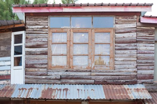 Old wood door and window on wall of house