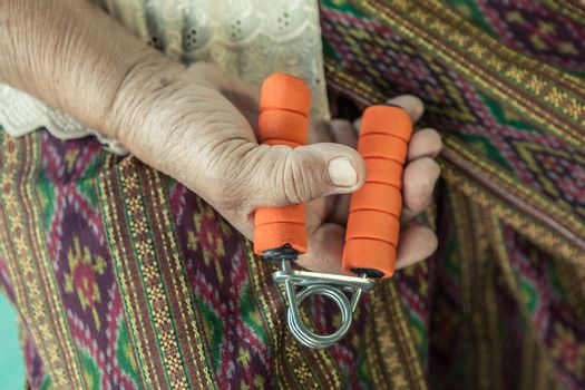 Senior asian woman exercise sport hand grip equipment
