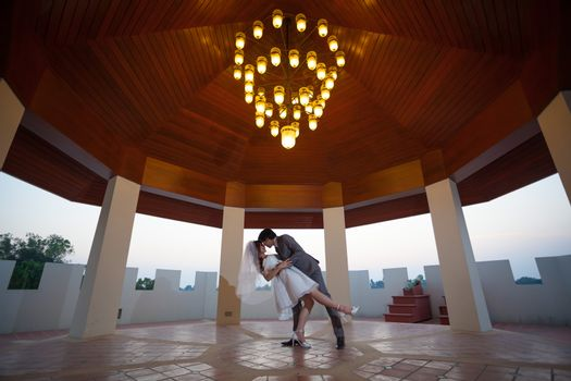 Loving asian couple with flower indoor