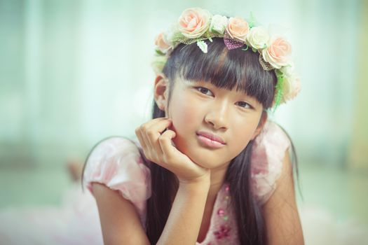 Portrait of a beautiful asian girl with flower crown