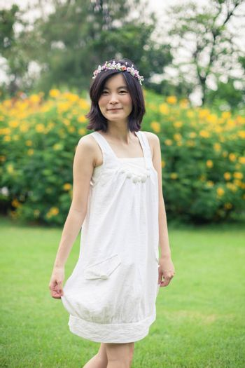 Beautiful asian young woman with a crown of flowers