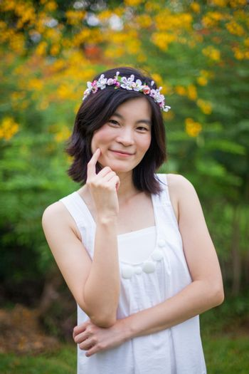 Young woman with a crown of flowers
