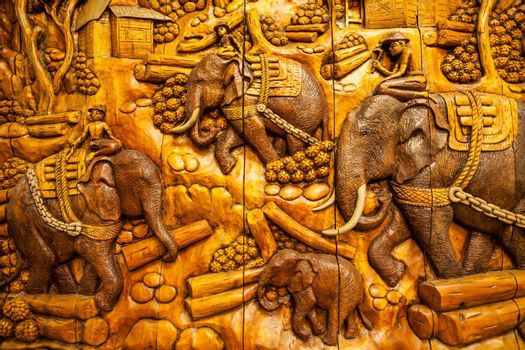 Carved Thai animals on the wood