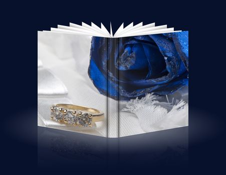 book of roses and wedding rings on white background