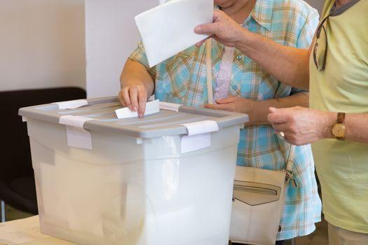 Senior citizens voting on democratic election.