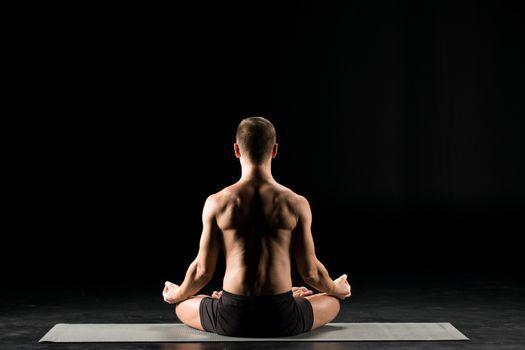 Man sitting in lotus position