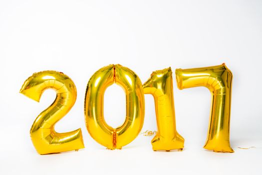 Golden 2017 sign balloons on white
