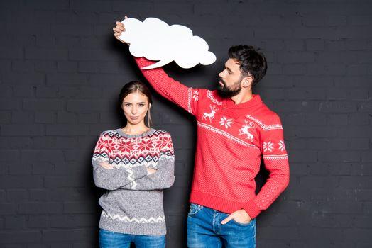 Man with speech bubble over girlfriend's head