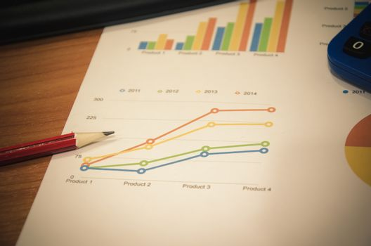business documents with charts growth, computer and pen. workplace