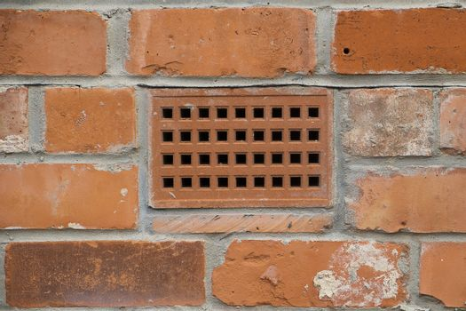 close up of air brick in a wall