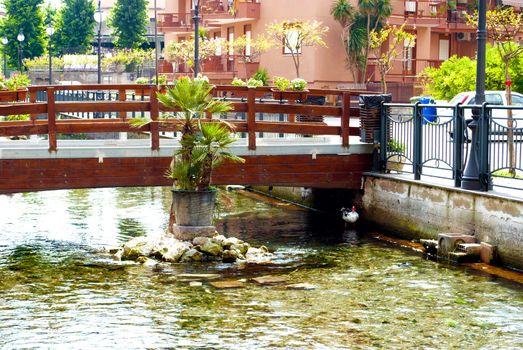 Pedestrian bridge across the river. City of Scafati, Italy. Architecture of a small southern Italian town.