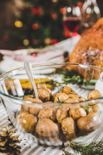 Close-up view of delicious roasted potatoes on festive table