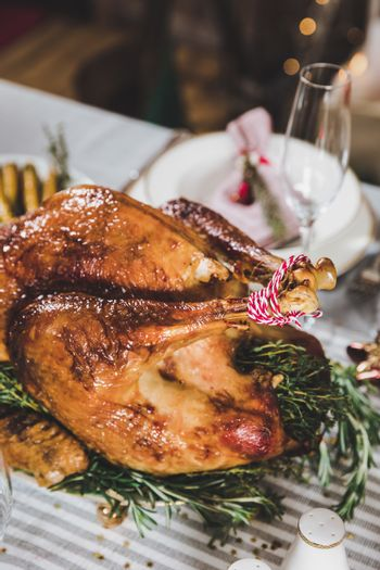 Close-up view of delicious roasted turkey on holiday table