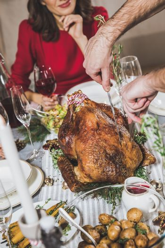Man carving roasted turkey