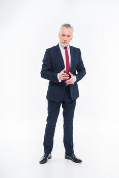 Mature businessman gesturing