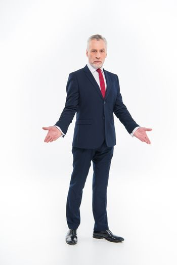 Confused mature businessman gesturing with hands on white
