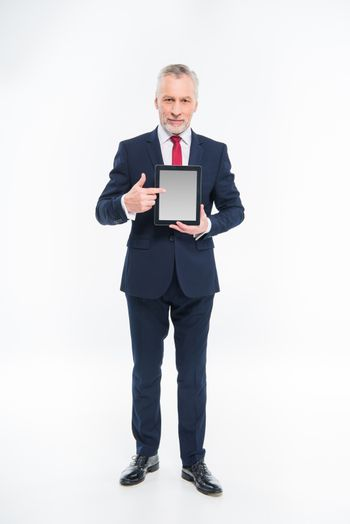 Businessman holding digital tablet and pointing on blank screen