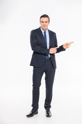 Professional businessman pointing with fingers and looking at camera