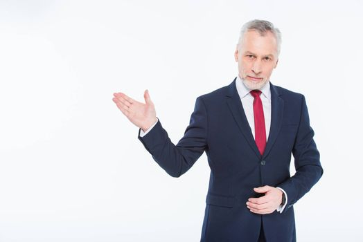 Handsome mature businessman showing with hand copy space