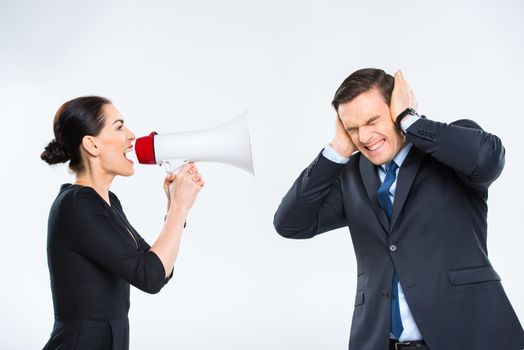 Businesswoman screaming at businessman