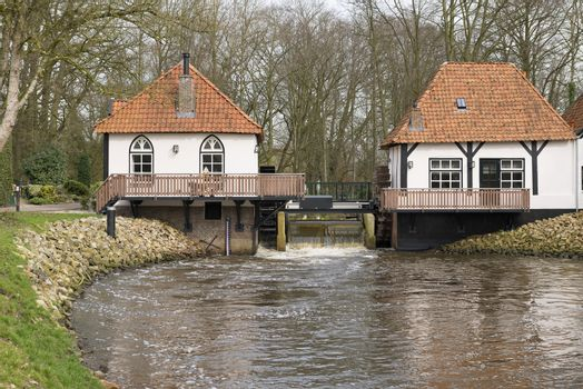 The recently restored historic water mill called The Olliemölle or Den Helder in the stream of the river the Boven-Slinge in Winterswijk in Hamlet the Achterhoek in the Netherlands. The water mill is a national monument and the restoration is completed in 2016.