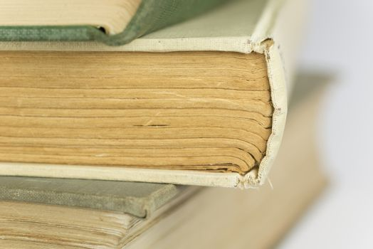 Stacked old bound and yellowed books as background picture