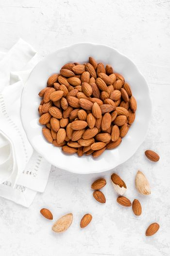 Almond nuts on white background directly above flat lay