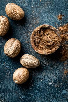Nutmeg on dark background directly above copy space