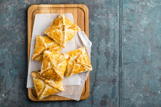 Crunchy puff pastry pies, homemade baking, top view