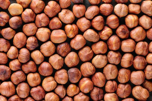 Background texture of Peeled hazelnuts macro closeup