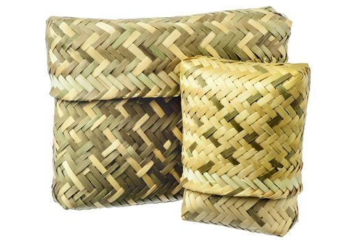 a basket  in a natural fibers woven on white background