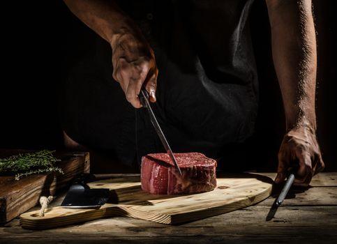 Chef butcher prepare beef steak