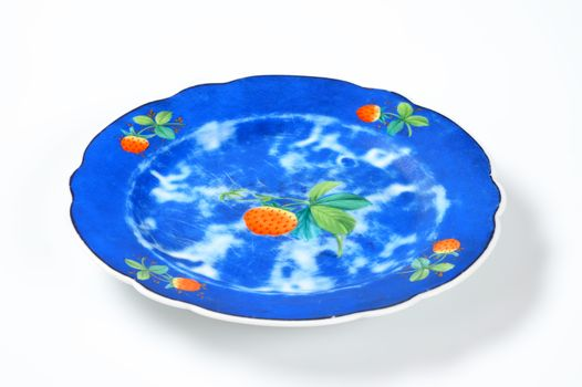 blue ceramic plate with strawberry design