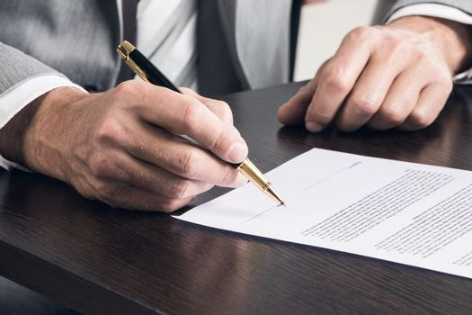 Businessman signing a contract
