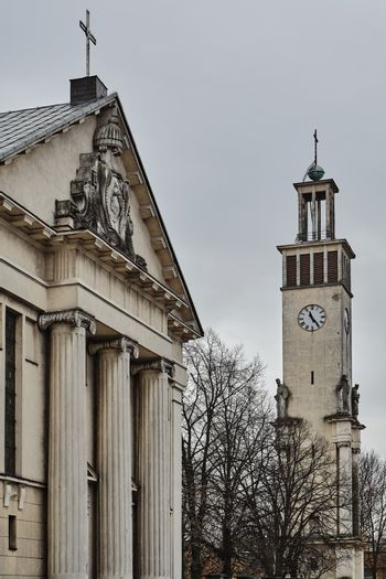 Neoclassical columns and campanile with statues