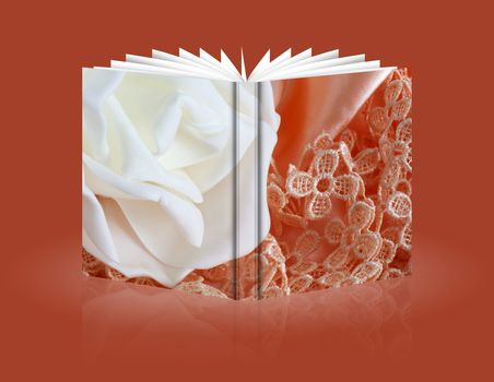 book of flowers candy and weddings favors on fabric background