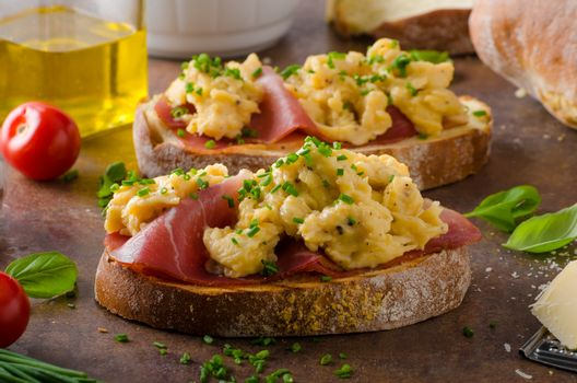 Delicious toasted bread with scrambled eggs