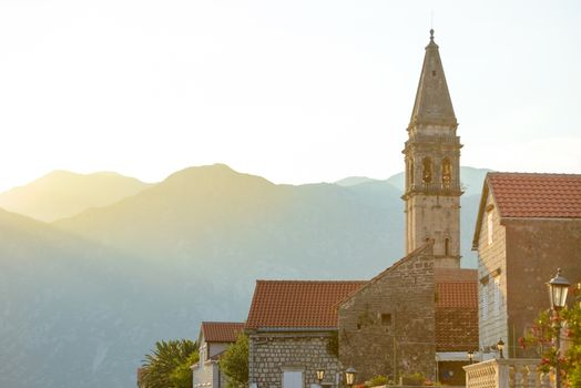 View of Famous Tower in Ancient Perast Town and Mountains on Kotor Bay (Boka Kotorska) at Sunset, Montenegro, Europe.