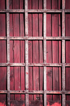 Iron lattice on a wooden door