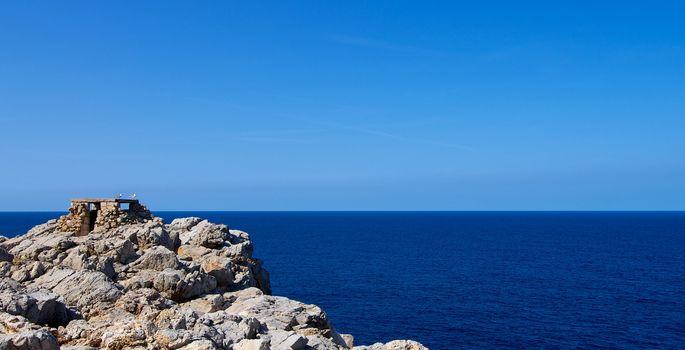 Historical Artillery Facilities near Punta Nati against Blue Sky Outdoors. North West of Menorca, Balearic Islands
