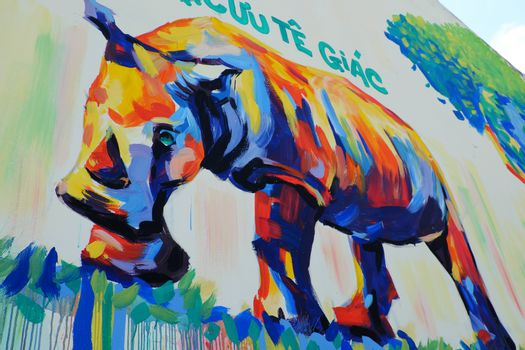 HO CHI MINH CITY, VIET NAM- MARCH 23, 2017: Propaganda campaign to Vietnamese don't use Rhino horn by graffiti art, Rhinoceros painting on wall, message people protect animal, meaningful street art