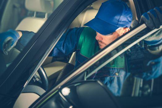 Car Mechanic Fixing Vehicle