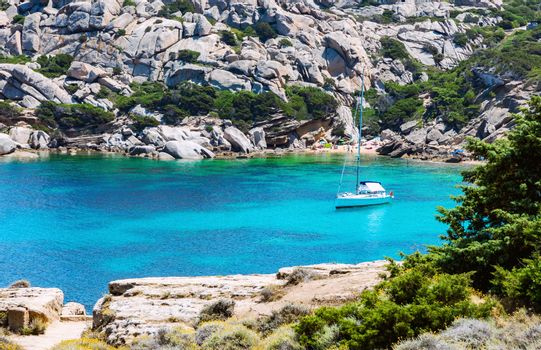 Picturesque view of Capo Testa beach with lonely yacht in Sardinia, Italy