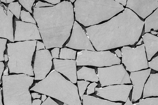 Cracked black and white concrete background