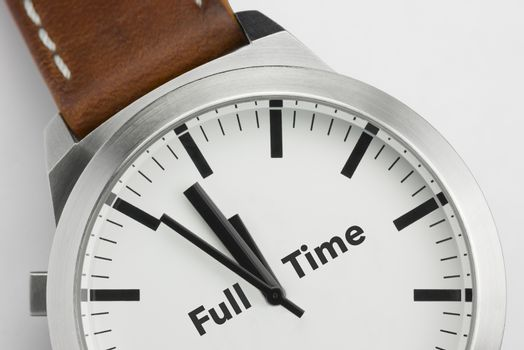 Analog watch with conceptual visualization of the text Full Time