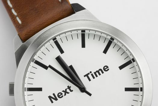 Analog watch with conceptual visualization of the text Next Time