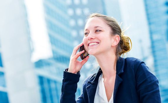 dynamic young executive calling outside, free of any constraint. Symbolizing a job search or a trade of outsourcing