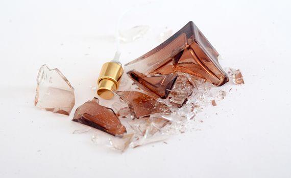 Picture of a Broken perfume bottle onj white