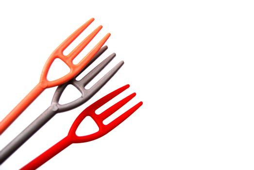 image of a three small disposlable plastic forks